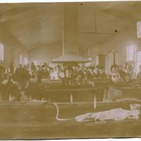 Students working with chemicals at lab benches, ca 1898.jpg